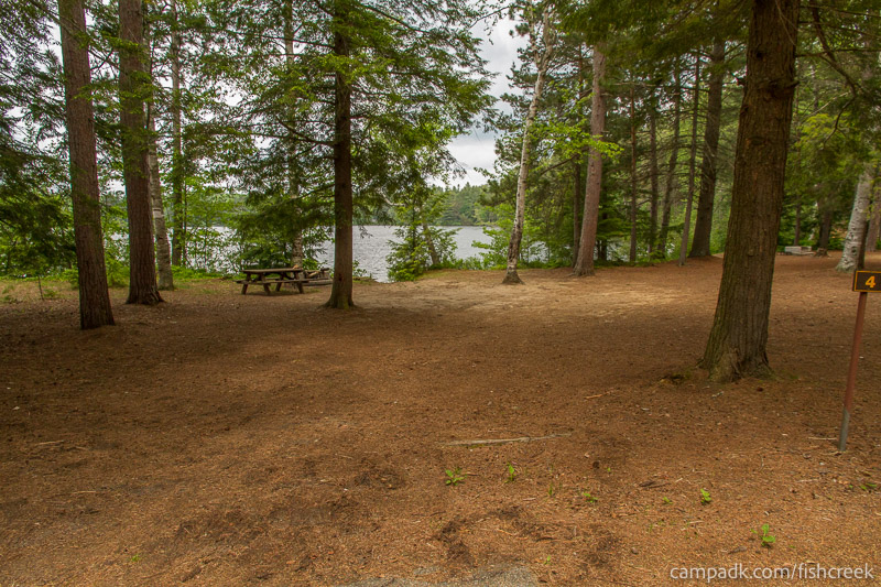 Campsite Photo of Site 4 at Fish Creek Pond Campground, New York - Looking at Site from Road Sign Visible