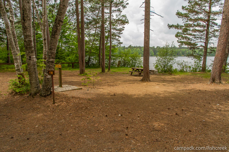Campsite Photo of Site 1W at Fish Creek Pond Campground, New York - Looking at Site from Road Sign Visible