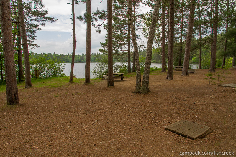Campsite Photo of Site 1W at Fish Creek Pond Campground, New York - Looking at Site from Road