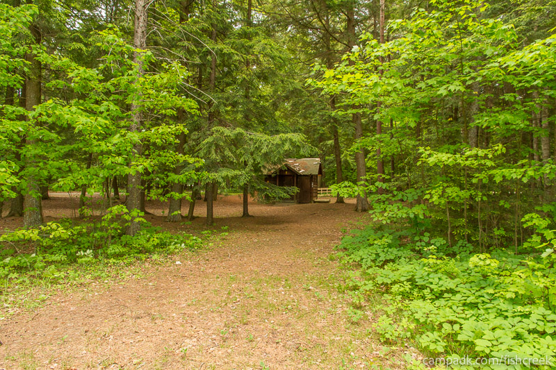 Campsite Photo of Site 1W at Fish Creek Pond Campground, New York - Washroom Across the Road