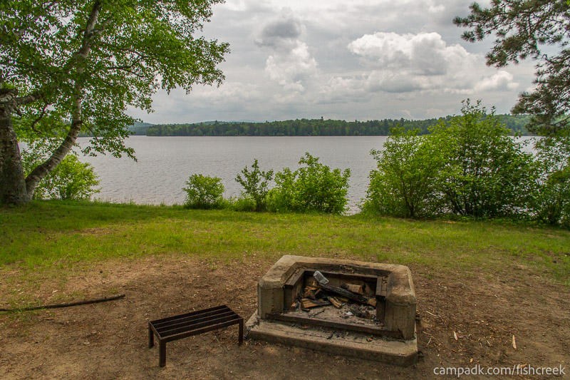 Campsite Photo of Site 105 at Fish Creek Pond Campground, New York - Fireplace View