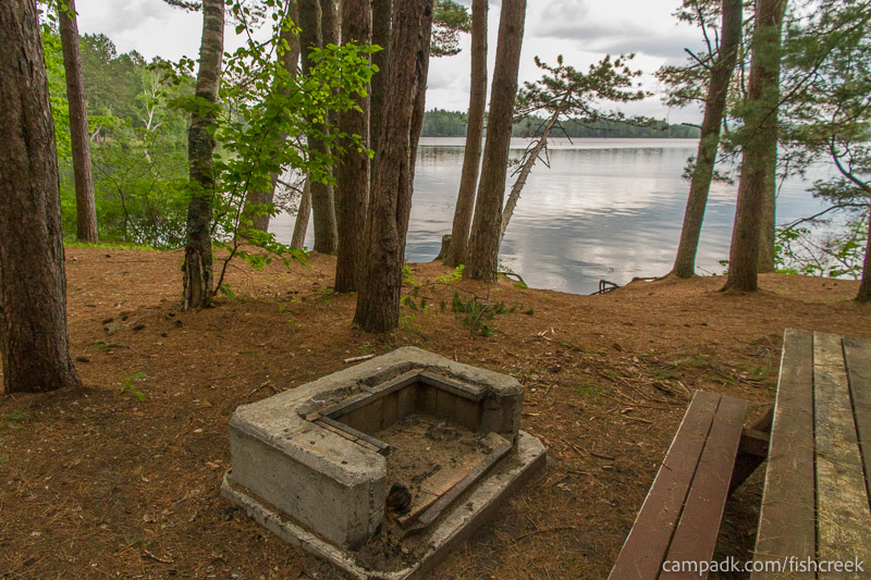 Campsite Photo of Site 133 at Fish Creek Pond Campground, New York - Fireplace View