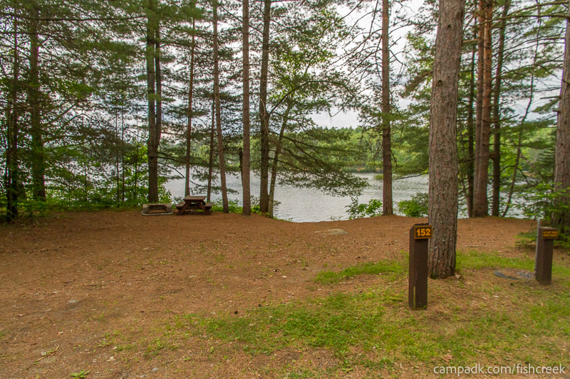 Campsite Photo of Site 152 at Fish Creek Pond Campground, New York - Looking at Site from Road Sign Visible