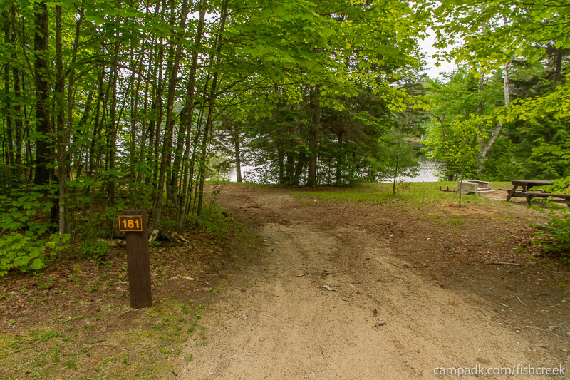 Campsite Photo of Site 161 at Fish Creek Pond Campground, New York - Looking at Site from Road Sign Visible
