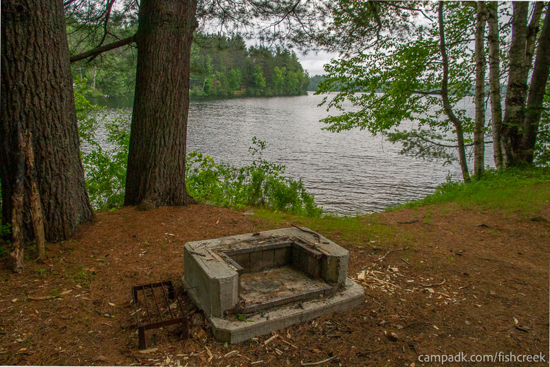 Campsite Photo of Site 169 at Fish Creek Pond Campground, New York - Fireplace View