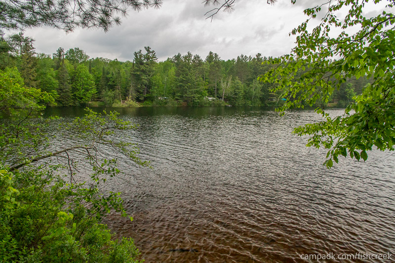 Campsite Photo of Site 169 at Fish Creek Pond Campground, New York - View from Shoreline