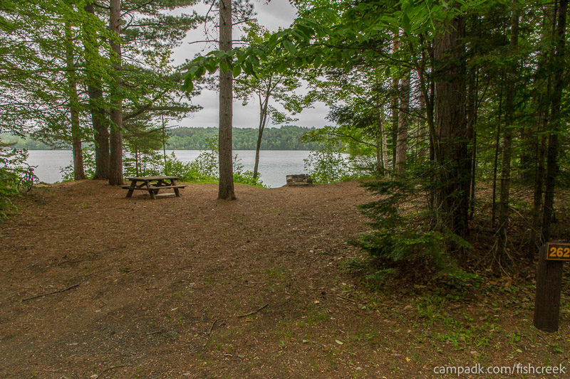 Campsite Photo of Site 262 at Fish Creek Pond Campground, New York - Looking at Site from Road Sign Visible