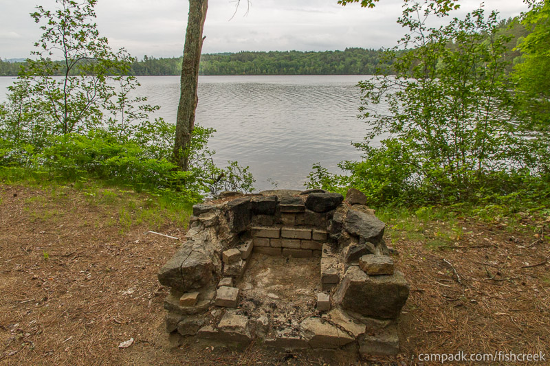 Campsite Photo of Site 262 at Fish Creek Pond Campground, New York - Fireplace View