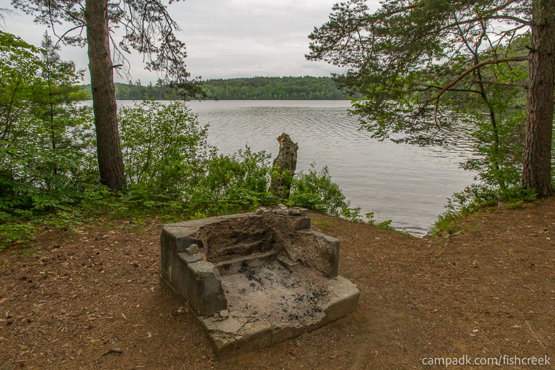 Campsite Photo of Site 263 at Fish Creek Pond Campground, New York - Fireplace View