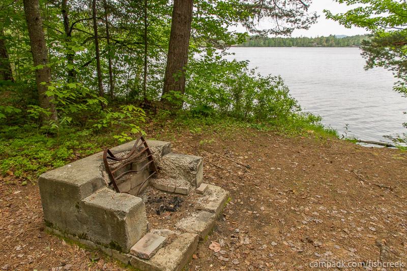 Campsite Photo of Site 266 at Fish Creek Pond Campground, New York - Fireplace View