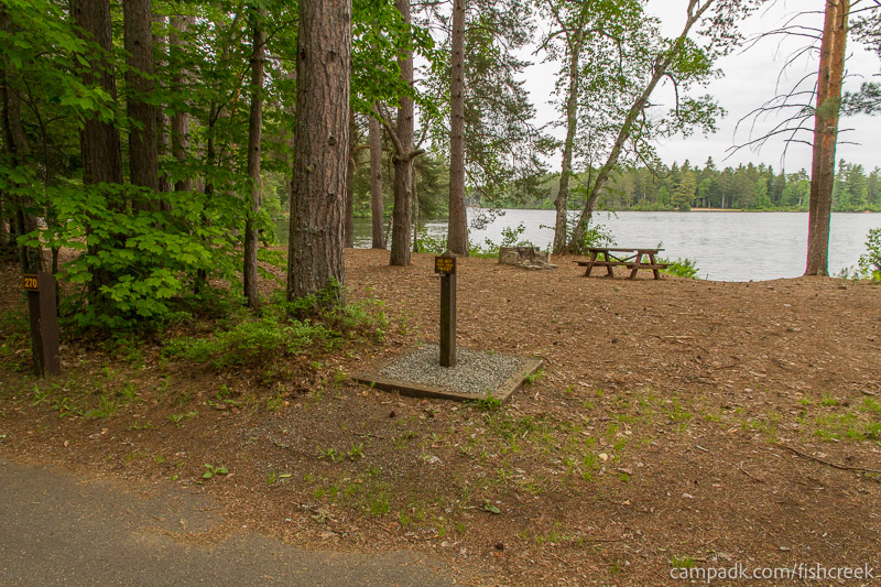 Campsite Photo of Site 270 at Fish Creek Pond Campground, New York - Looking at Site from Road Sign Visible