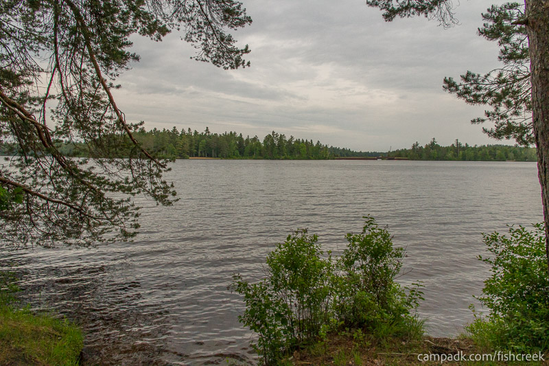 Campsite Photo of Site 274 at Fish Creek Pond Campground, New York - View from Shoreline