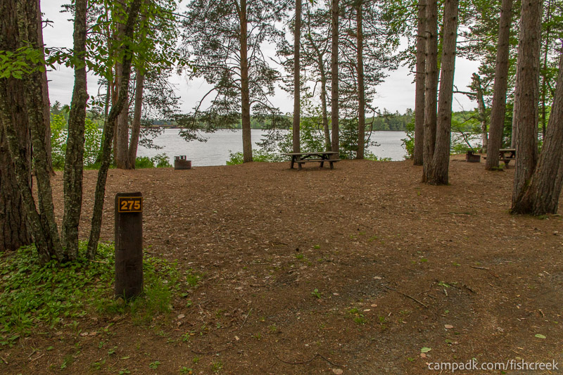 Campsite Photo of Site 275 at Fish Creek Pond Campground, New York - Looking at Site from Road Sign Visible