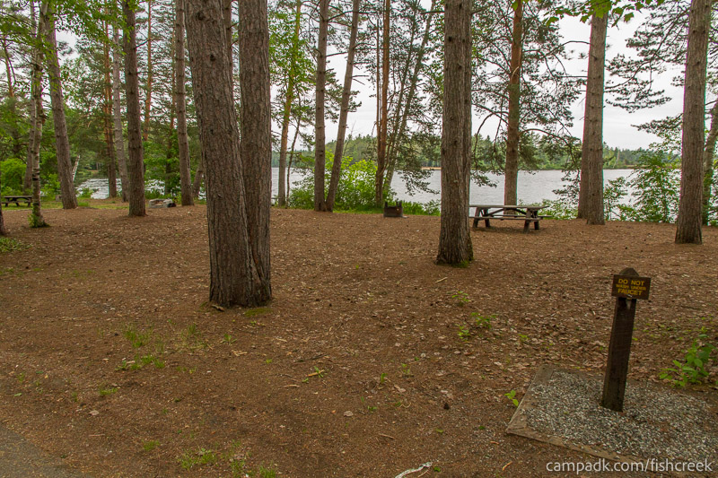 Campsite Photo of Site 275 at Fish Creek Pond Campground, New York - Looking at Site from Road