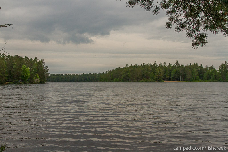 Campsite Photo of Site 275 at Fish Creek Pond Campground, New York - View from Shoreline