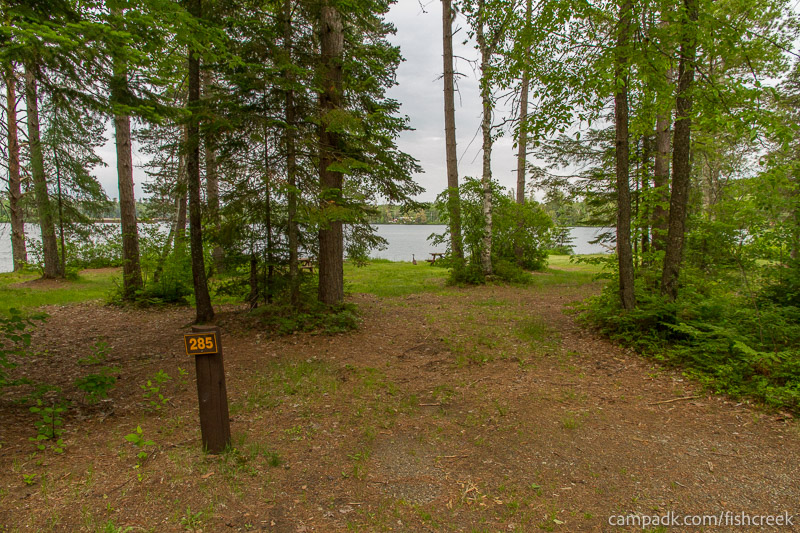 Campsite Photo of Site 285 at Fish Creek Pond Campground, New York - Looking at Site from Road Sign Visible