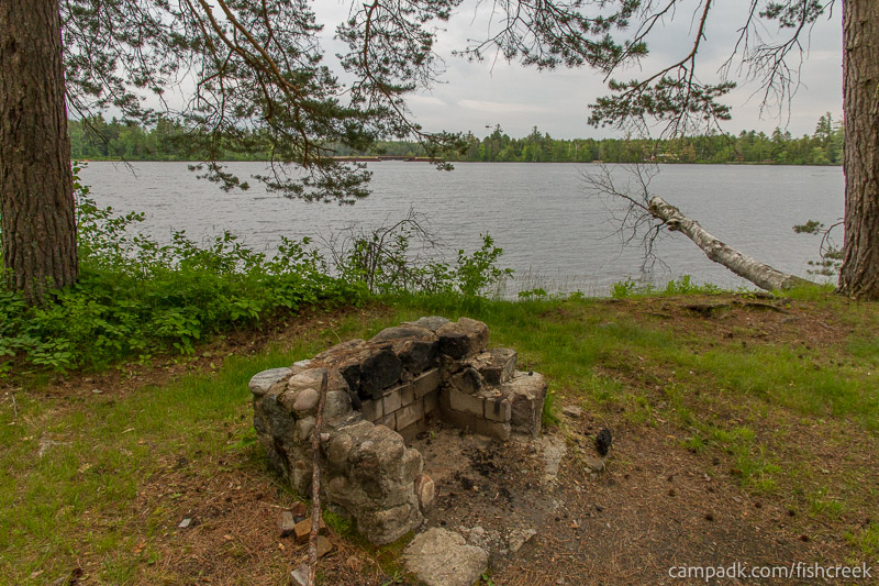 Campsite Photo of Site 285 at Fish Creek Pond Campground, New York - Fireplace View