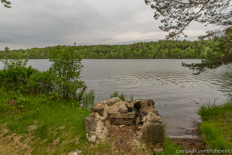 Campsite Photo of Site 289 at Fish Creek Pond Campground, New York - Fireplace View