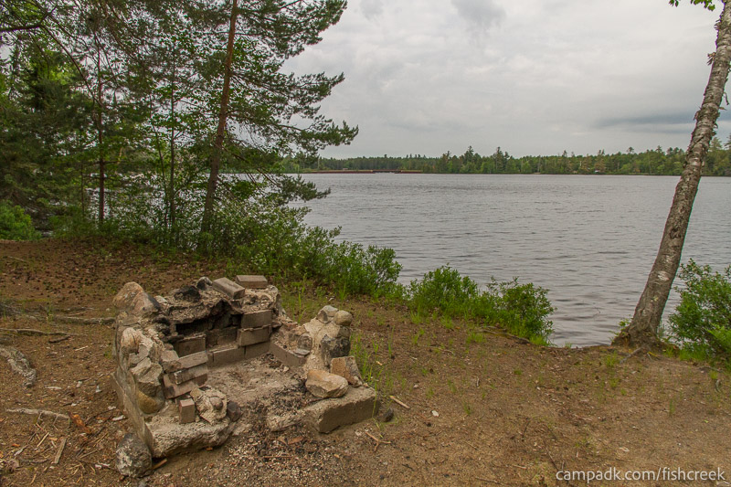 Campsite Photo of Site 294 at Fish Creek Pond Campground, New York - Fireplace View