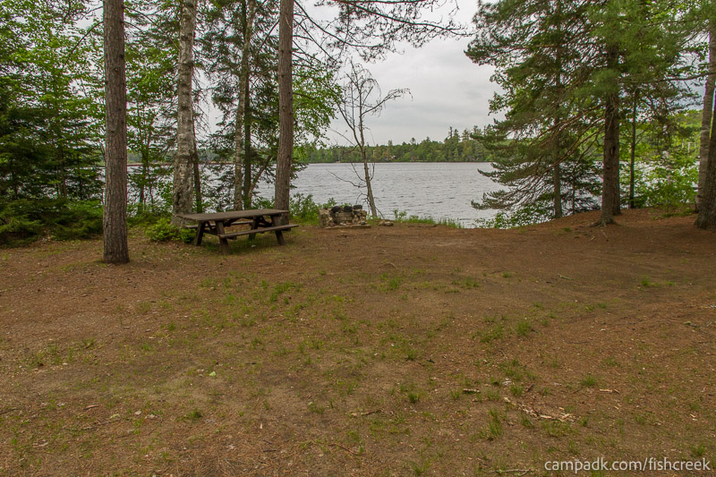 Campsite Photo of Site 297 at Fish Creek Pond Campground, New York - Looking at Site from Part Way In