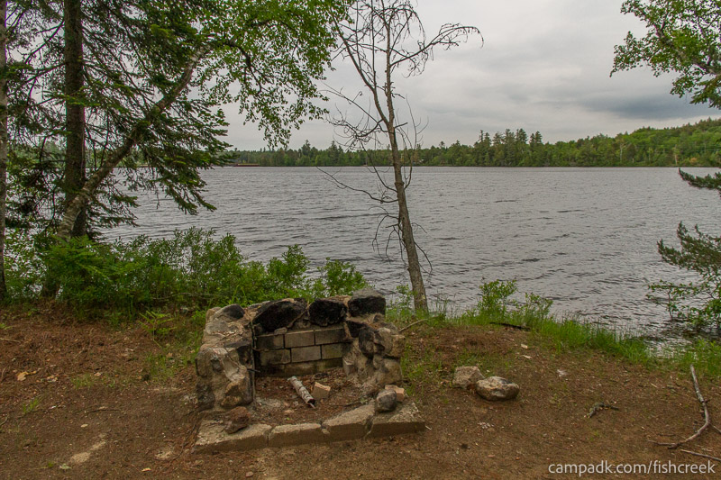 Campsite Photo of Site 297 at Fish Creek Pond Campground, New York - Fireplace View