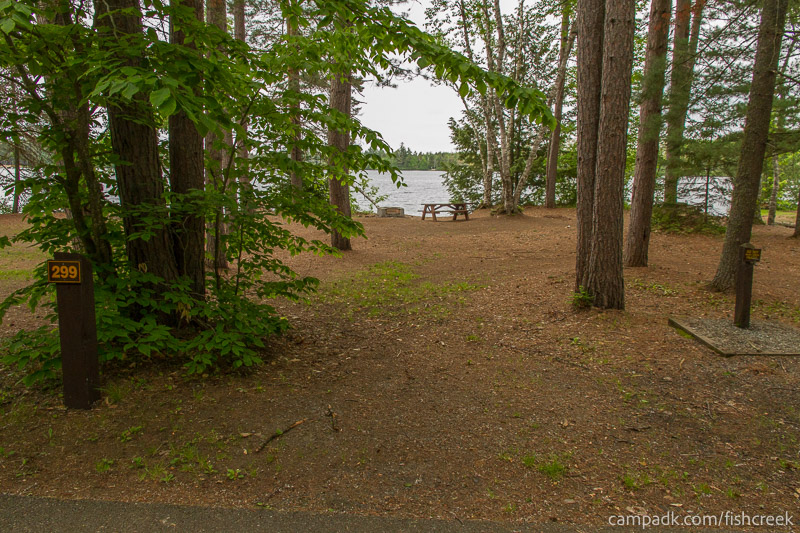 Campsite Photo of Site 299 at Fish Creek Pond Campground, New York - Looking at Site from Road Sign Visible