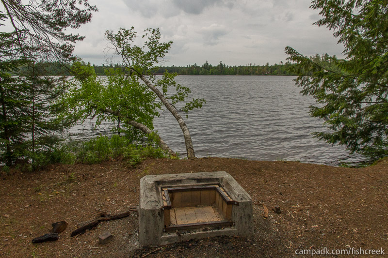 Campsite Photo of Site 299 at Fish Creek Pond Campground, New York - Fireplace View