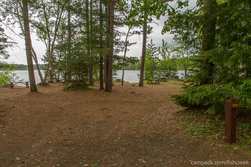 Campsite Photo of Site 300 at Fish Creek Pond Campground, New York - Looking at Site from Road Sign Visible
