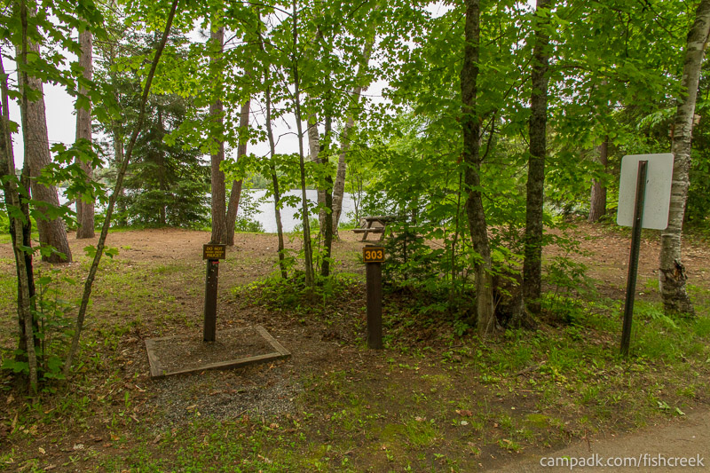 Campsite Photo of Site 303 at Fish Creek Pond Campground, New York - Looking at Site from Road Sign Visible