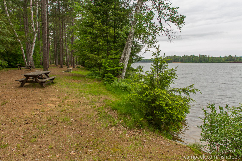 Campsite Photo of Site 304 at Fish Creek Pond Campground, New York - Cross Site View