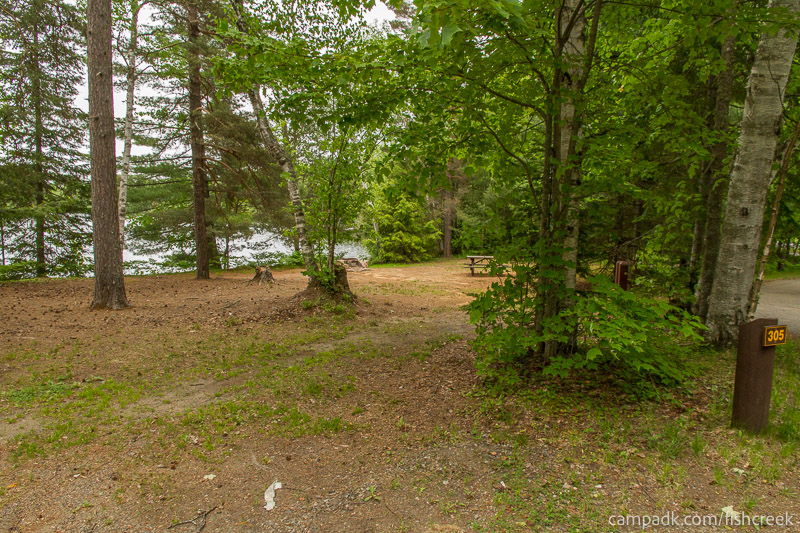Campsite Photo of Site 305 at Fish Creek Pond Campground, New York - Looking at Site from Road Sign Visible