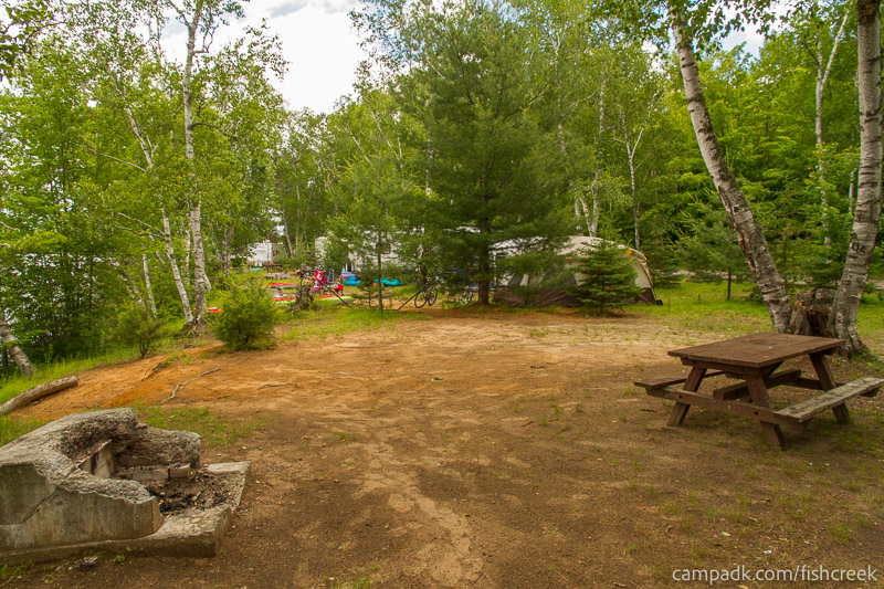 Campsite Photo of Site 180 at Fish Creek Pond Campground, New York - Cross Site View
