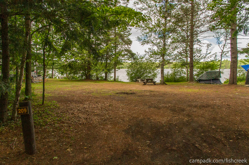 Campsite Photo of Site 209 at Fish Creek Pond Campground, New York - Looking at Site from Road Sign Visible