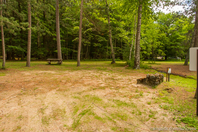 Campsite Photo of Site B3 at Fish Creek Pond Campground, New York - Looking at Site from Road Sign Visible
