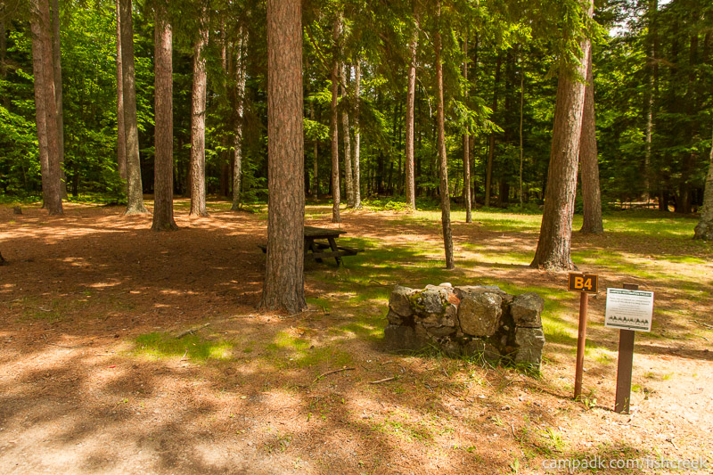 Campsite Photo of Site B4 at Fish Creek Pond Campground, New York - Looking at Site from Road Sign Visible
