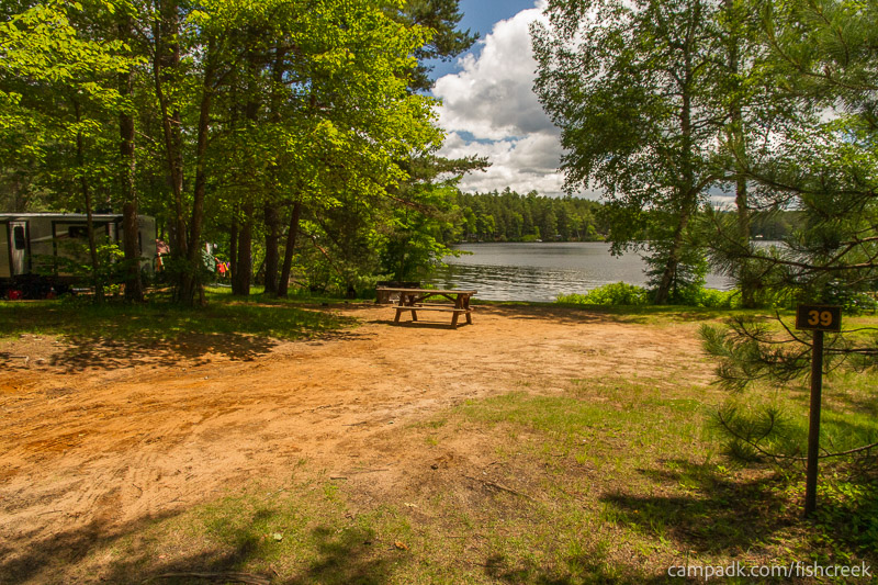 Campsite Photo of Site 39 at Fish Creek Pond Campground, New York - Looking at Site from Road Sign Visible