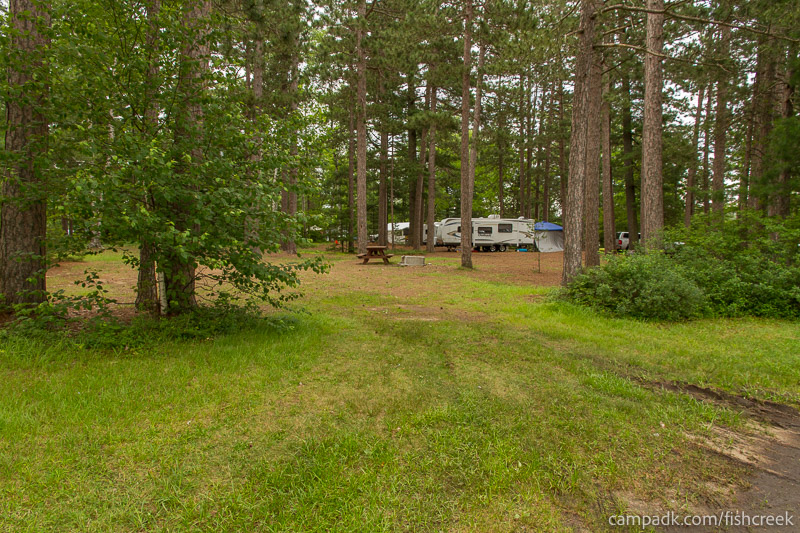 Campsite Photo of Site A14 at Fish Creek Pond Campground, New York - Looking at Site from Road