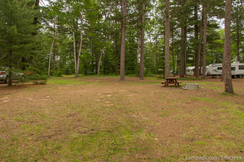 Campsite Photo of Site A14 at Fish Creek Pond Campground, New York - Looking at Site from Part Way In
