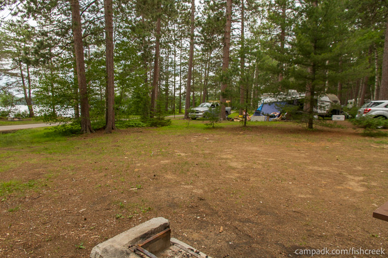 Campsite Photo of Site A14 at Fish Creek Pond Campground, New York - Cross Site View