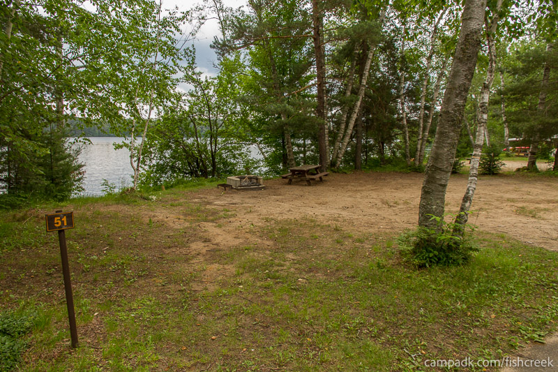 Campsite Photo of Site 51 at Fish Creek Pond Campground, New York - Looking at Site from Road Sign Visible