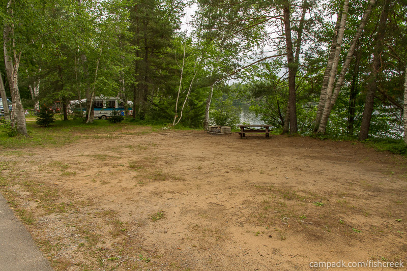 Campsite Photo of Site 51 at Fish Creek Pond Campground, New York - Looking at Site from Road