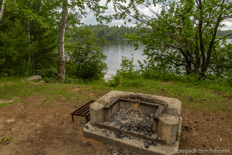 Campsite Photo of Site 51 at Fish Creek Pond Campground, New York - Fireplace View