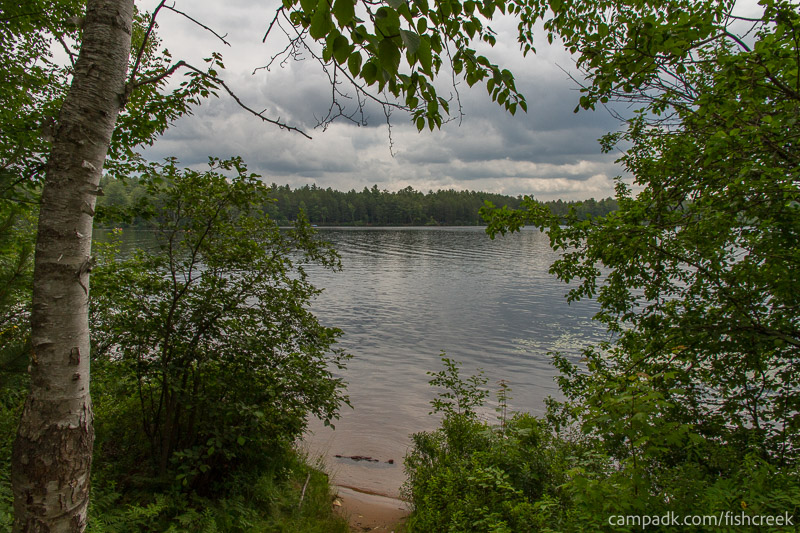 Campsite Photo of Site 51 at Fish Creek Pond Campground, New York - Shoreline and View