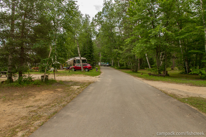 Campsite Photo of Site 51 at Fish Creek Pond Campground, New York - View Down Road from Campsite