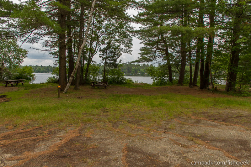 Campsite Photo of Site 31 at Fish Creek Pond Campground, New York - Looking at Site from Road Sign Visible