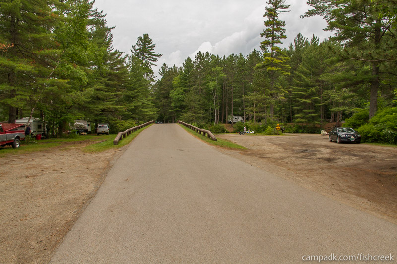 Campsite Photo of Site 31 at Fish Creek Pond Campground, New York - View Down Road from Campsite