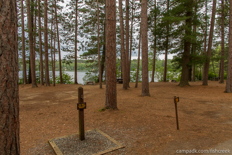 Campsite Photo of Site 19 at Fish Creek Pond Campground, New York - Looking at Site from Road Sign Visible