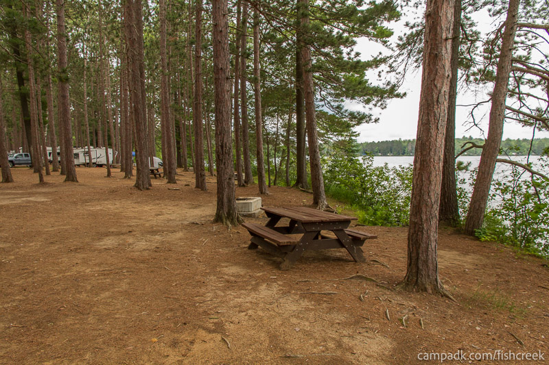 Campsite Photo of Site 19 at Fish Creek Pond Campground, New York - Cross Site View