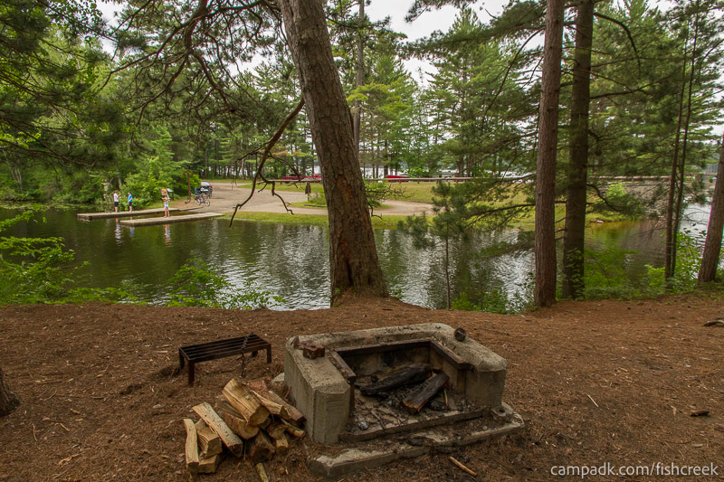 Campsite Photo of Site C9 at Fish Creek Pond Campground, New York - Fireplace View
