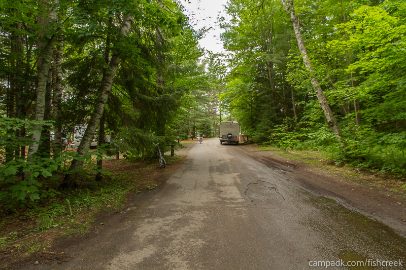 Campsite Photo of Site 147 at Fish Creek Pond Campground, New York - View Down Road from Campsite